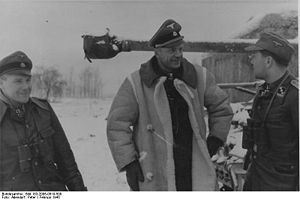 Heinz Harmel with two members of the division in February 1945.