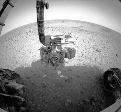 Spirit Rover Examines the Martian Soil.