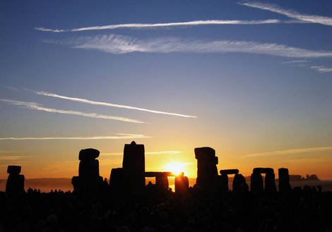 sun rising over Stonehenge.