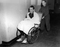 SS-Ernst Kaltenbrunner at Nuremberg Trials being wheeled into court after an illness