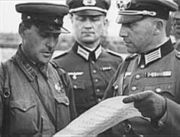 Soviet (left) and German officers meet after the Soviets' invasion of Poland