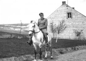 Amon Goth riding on horseback through Plaszów Labor Camp in the summer of 1943