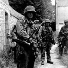 Grenadiers of SS-Obersturmbannführer Wilhelm Mohnke's SS-Panzergrenadier Regiment 26 near Norrey-en-Bessin,