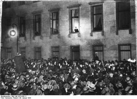 Hitler at a window of the Reich's Chancellory.