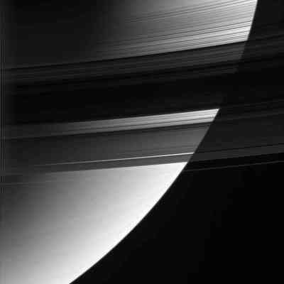 Saturn's rings from their unlit side.