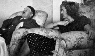 Adolf Hitler and Eva Braun relax in the Bunker.