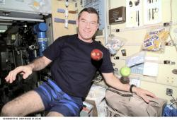 Astronaut James S. Voss, choosing an apple. Image credit: NASA.