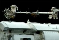 Spacewalkers outside the station. Image credit: NASA TV.