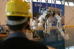Eurobot is lowered into the water at EAC's Neutral Buoyancy Facility. Source: ESA.