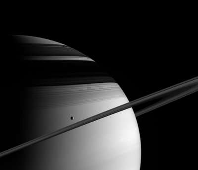 Saturn's Moon Tethys glides past in its orbit.