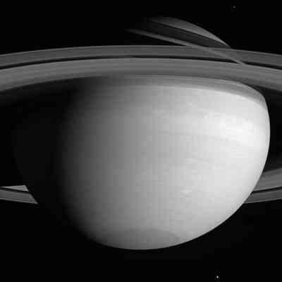 Tethys and Mimas circling Saturn.